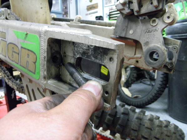 stuck swing arm bolt
